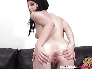Young Rachel toys pussy before black couch casting creampie