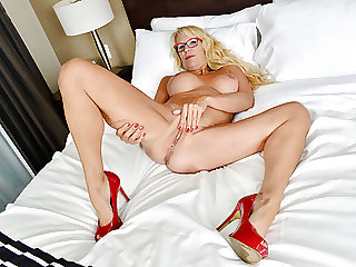 Canadian milf Bianca masturbates with curtains wide open