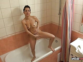Hot babe takes care of herself while showering