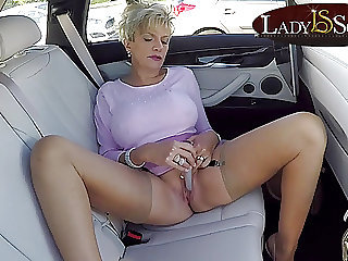 Busty mature Lady Sonia masturbates in her car