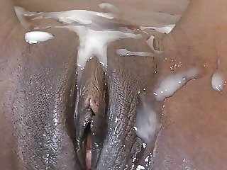 Chocolate pussy covered with thick cum