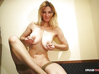 MILF in stockings teases with her magnificent body