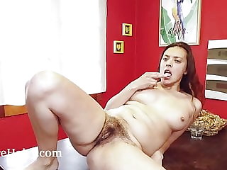 Fanny masturbates on her wooden table