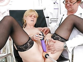 Horny granny caught cumming with fucking machine