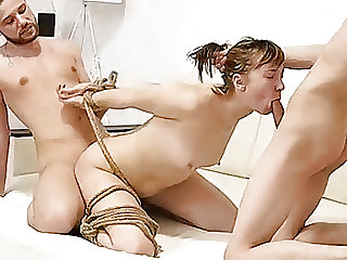 Sexy Cute Babe in Threesome Bondage Action Takes Hard Dicks