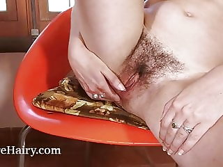 Anika masturbates on her red chair