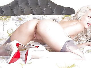 Horny blonde Liz Rainbow wanks in ff nylons and leather heels