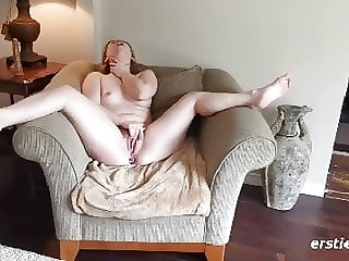 Ella Spreads On Her Living Room Chair