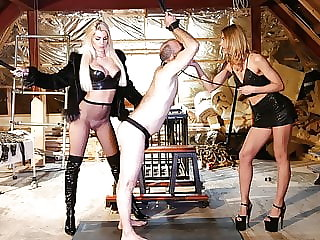 Two blonde dominatrixes use their sex slave