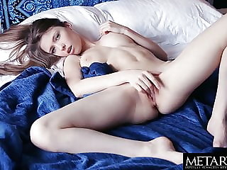 Busty plays with her tits as she fingers her soaked pussy