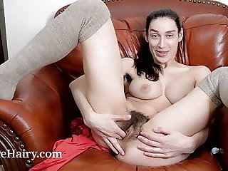 Janetta stays warm by masturbating on her chair