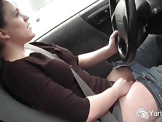 Yanks Beauty Lou is driving and rubbing her wet pussy