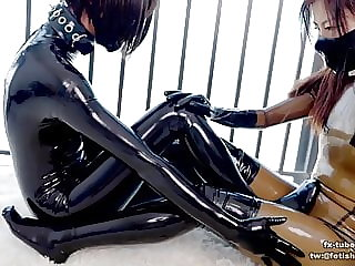 Latex lesbian breathplay with vacuum bag Part 1
