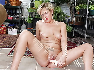 Pantyhosed mature Diamond sits on a dildo