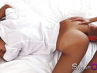 StrapOn Two hot lesbians playing with long red strapon dildo