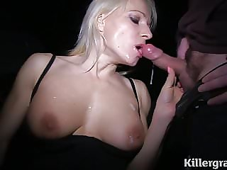 Blonde Milf sucking cocks in public