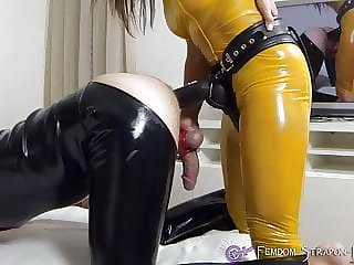 Fucking slave with strapon and sucking his cock