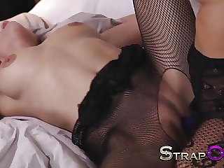 StrapOn Lesbians in black fishnets fuck with purple strapon