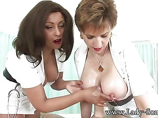 Lady Sonia and friend give oily hadjob cum big tits